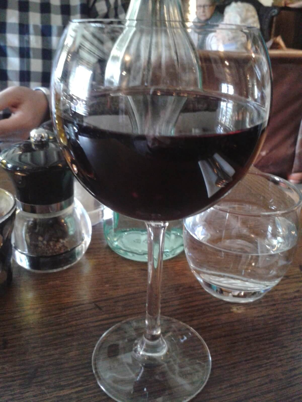 How safe is a glass of wine for our health? Large glass of Malbec red wine
