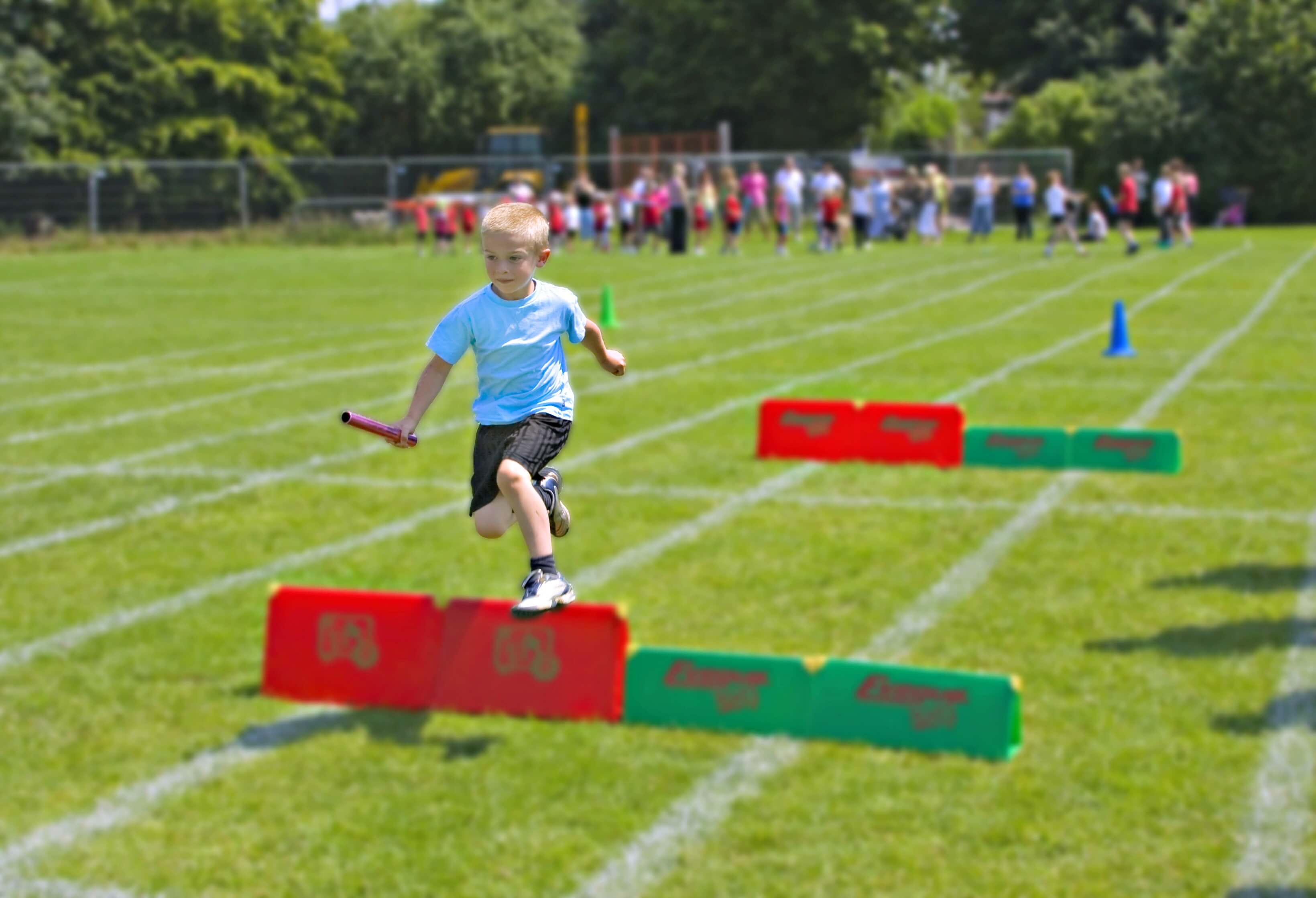 school sports day - boy running the relay race