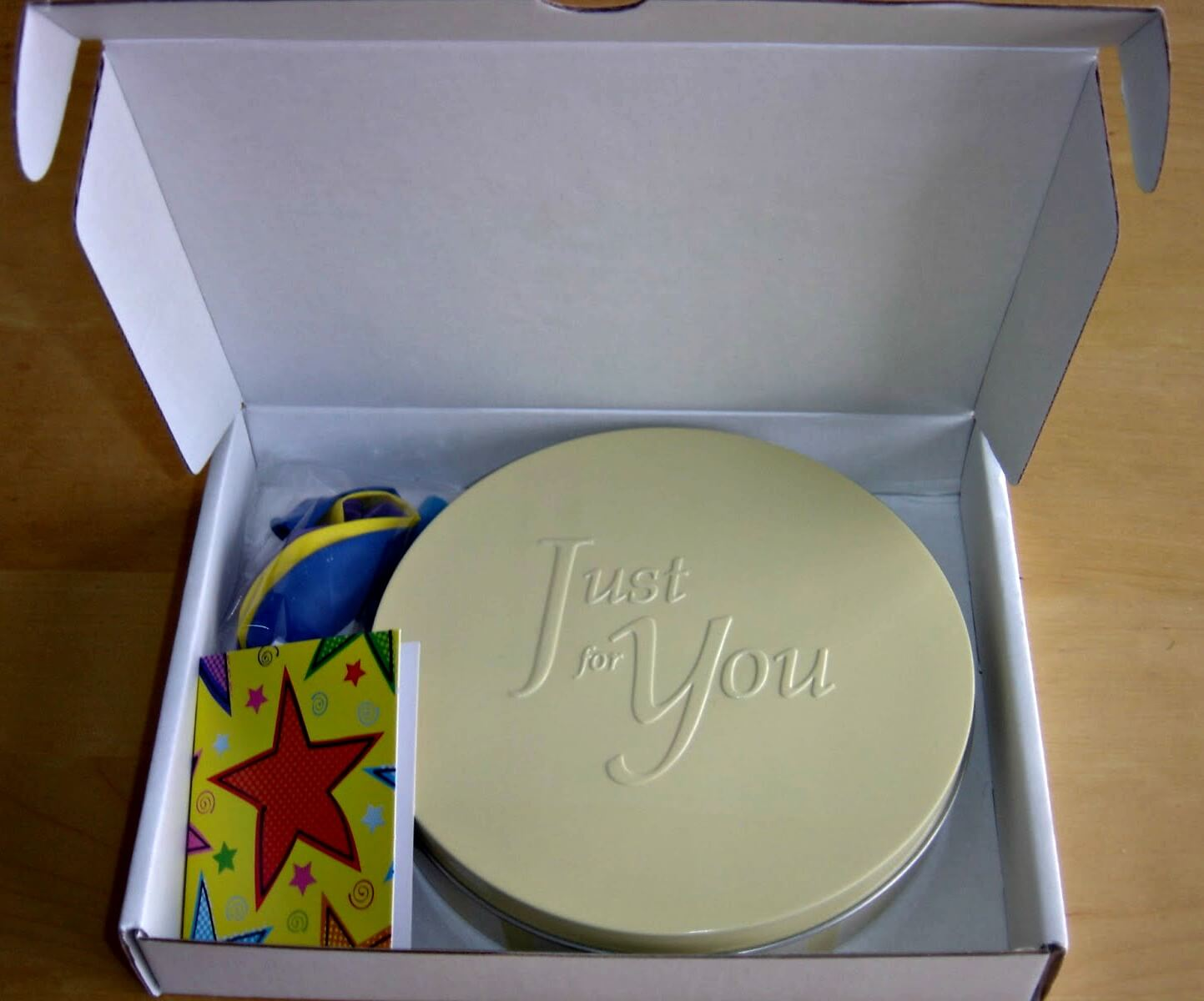 Baker Days letterbox cakes - the birthday cake in its packaging - a tin within a box.