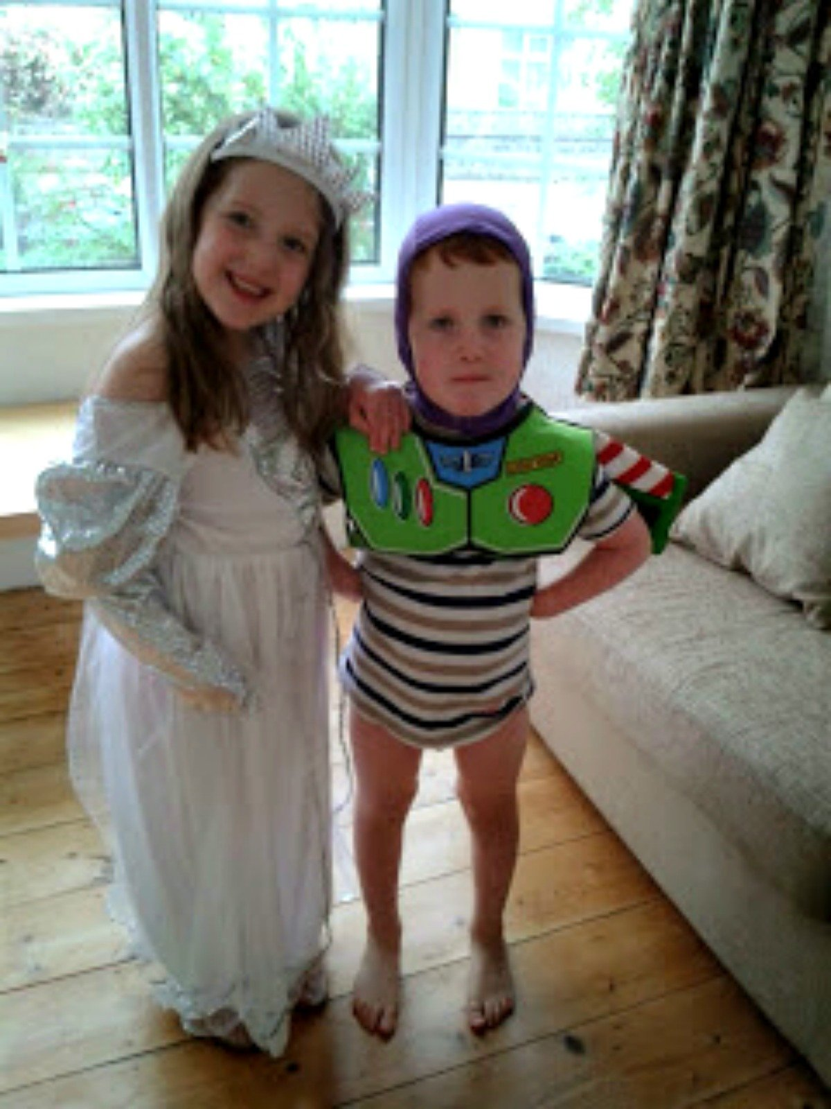 entertaining children - Caitlin as a princess and Ieuan as Buzz Lightyear