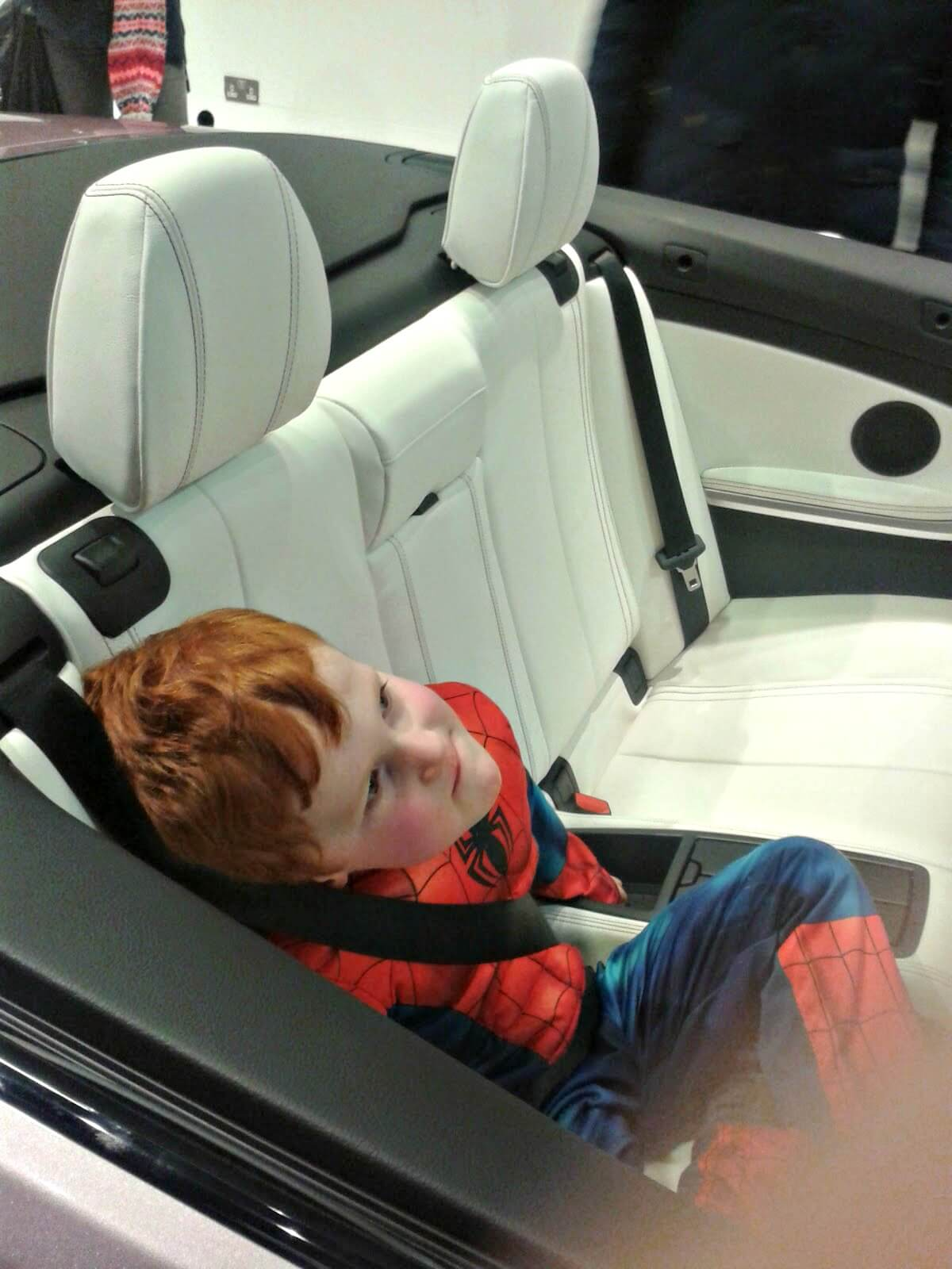 Child can travel in the front of a car - Ieuan in the BMW convertible.