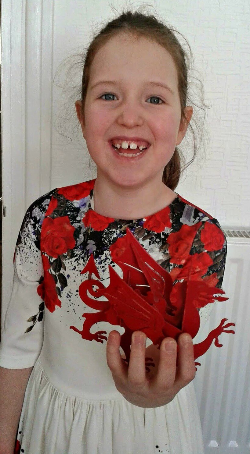 poem for St. David's Day - Caitlin holds her bard's dragon trophy aloft