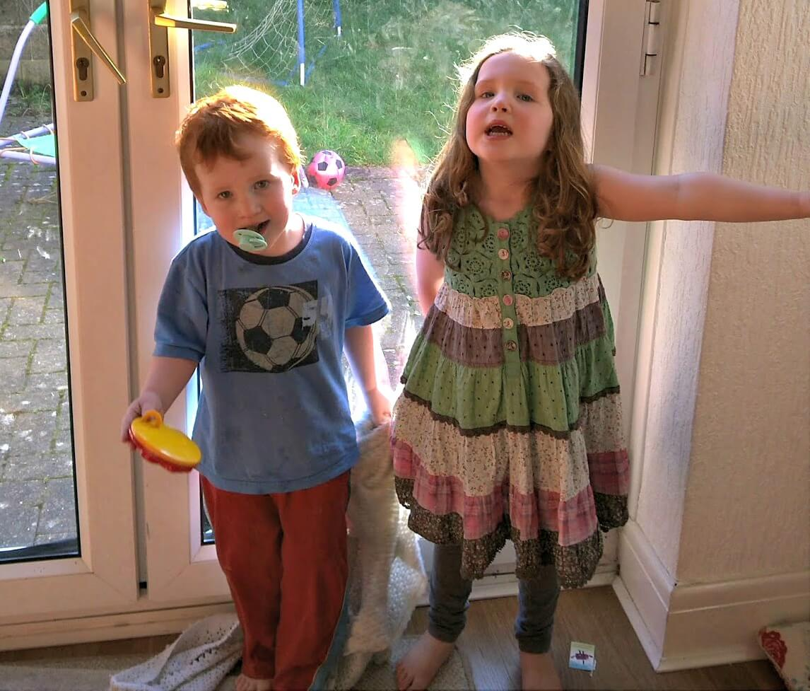 what does a babysitter need to know - Caitlin and Ieuan at home by the back door