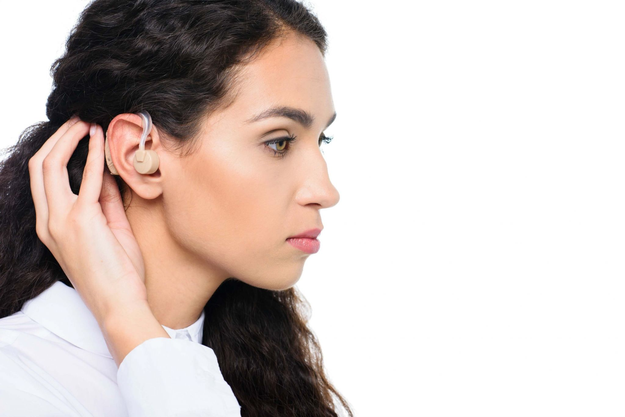 early onset hearing loss - woman wearing a hearing aid