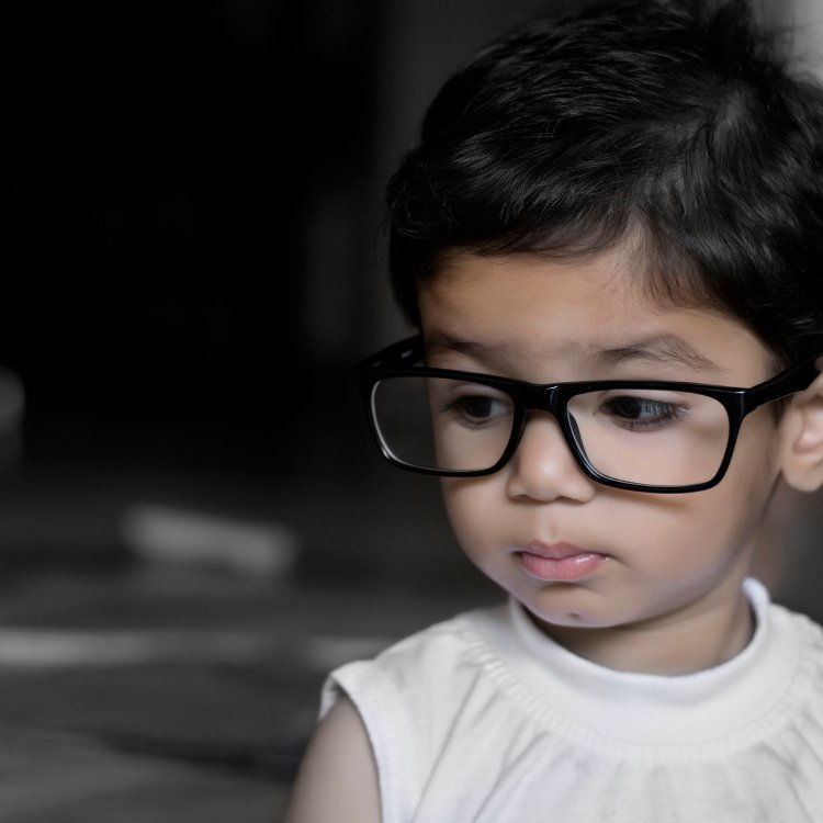 Reasons to take your child to the optician - studious child wearing black specs