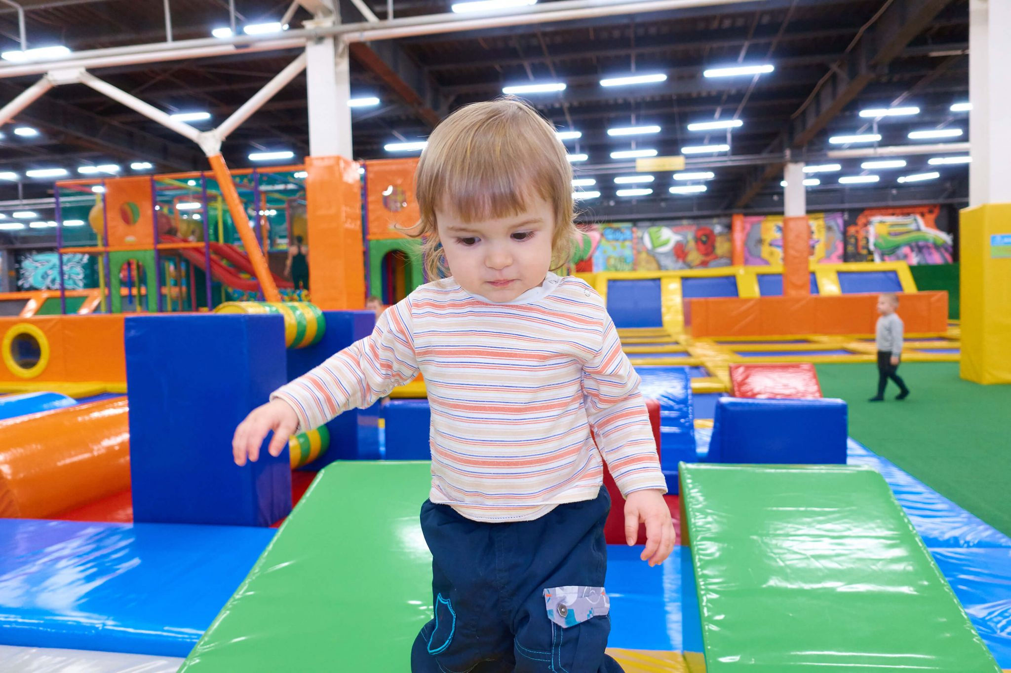 One year old child playing in a soft play centre