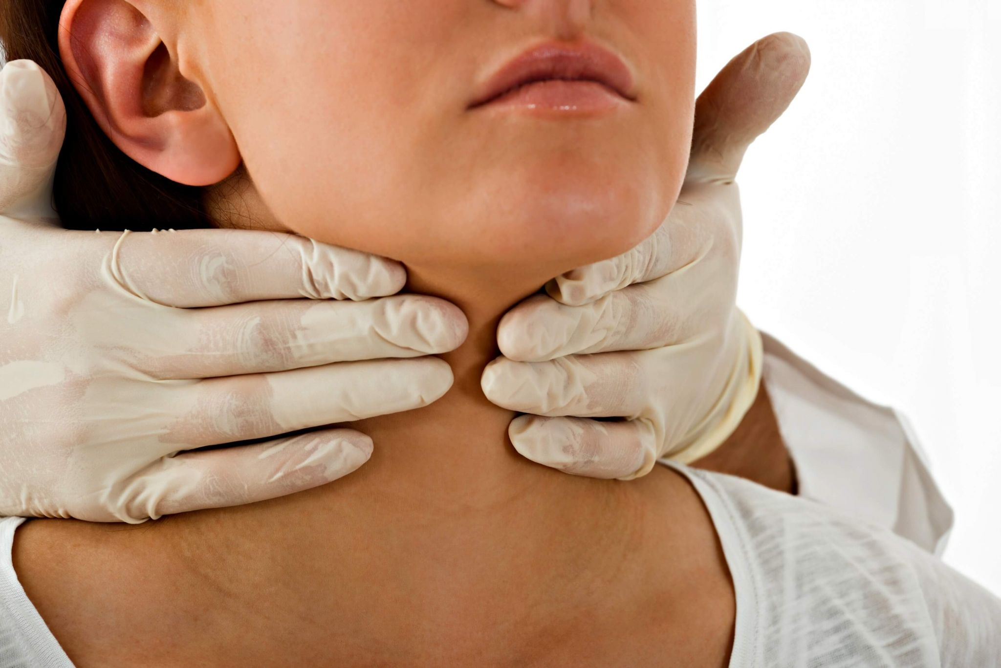 underactive thyroid symptoms - woman having her neck examined