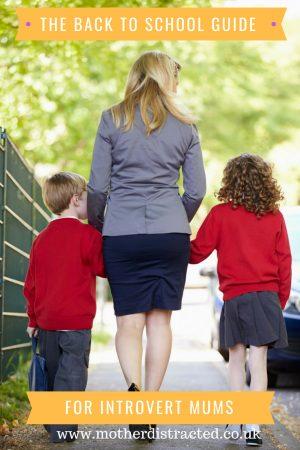 Mum walking her son and daughter to school