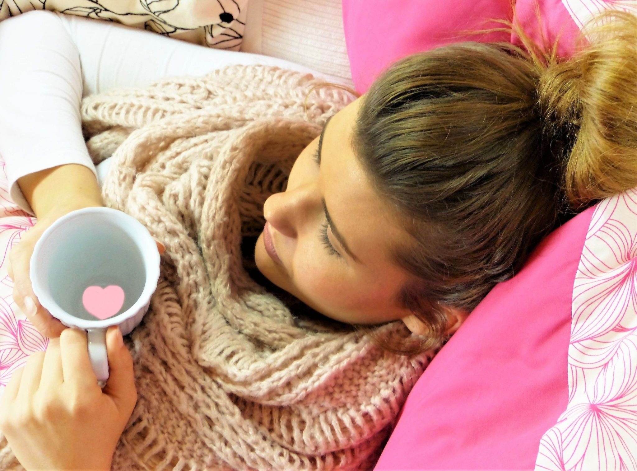 Tips for avoiding colds and flu - girl in bed feeling poorly
