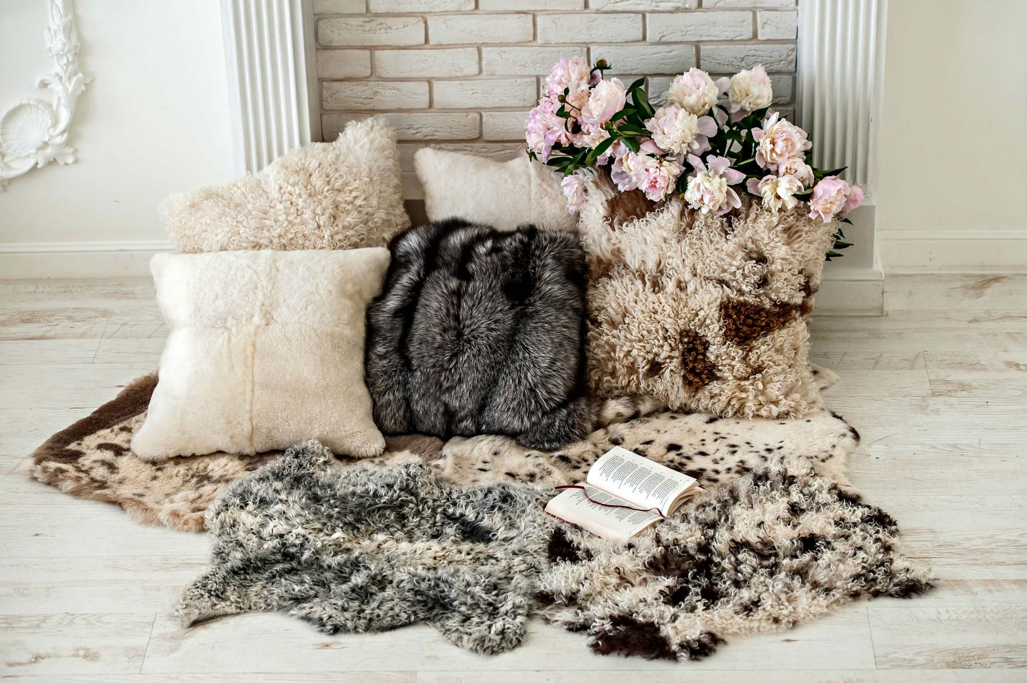 make your house a home - pile of faux fur cushions and rugs