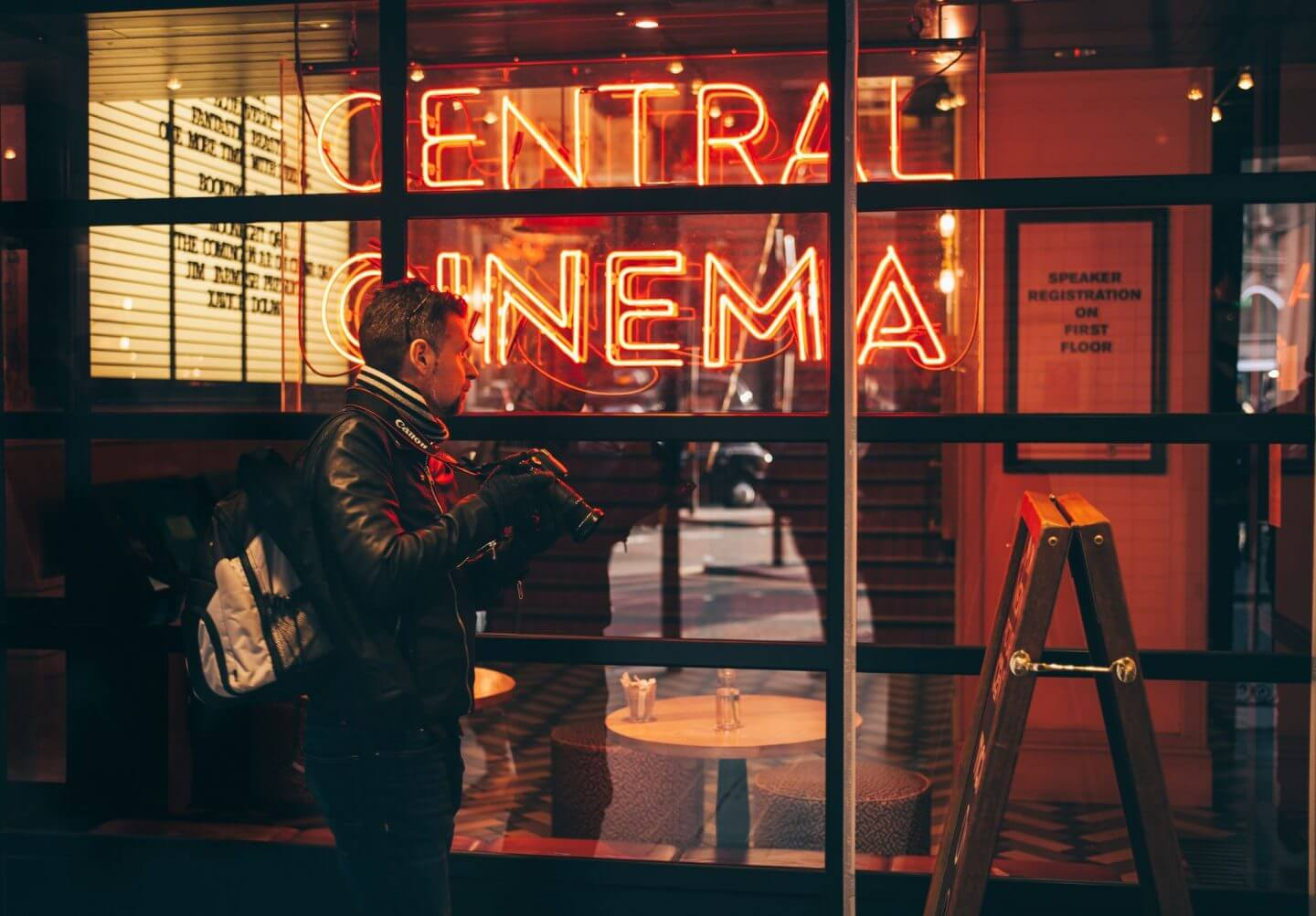 Man outside central cinema sign - best classic movies