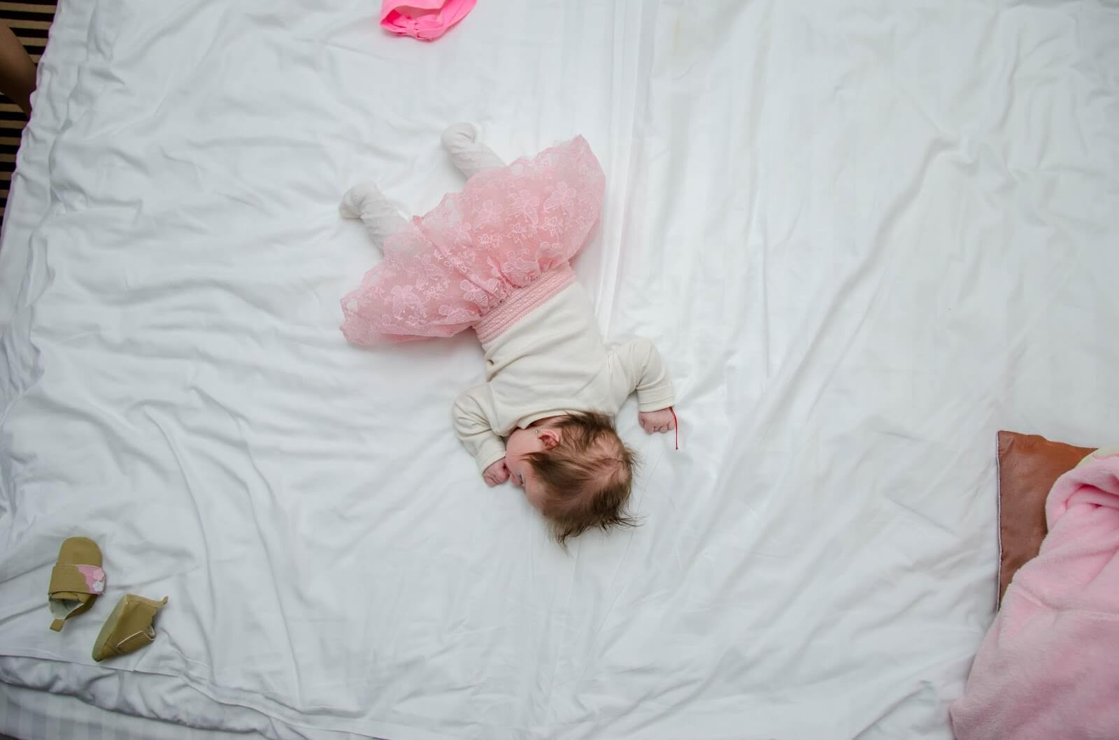 clocks go forward - coping when you have little ones. Little girl in a pink tutu on a white bed