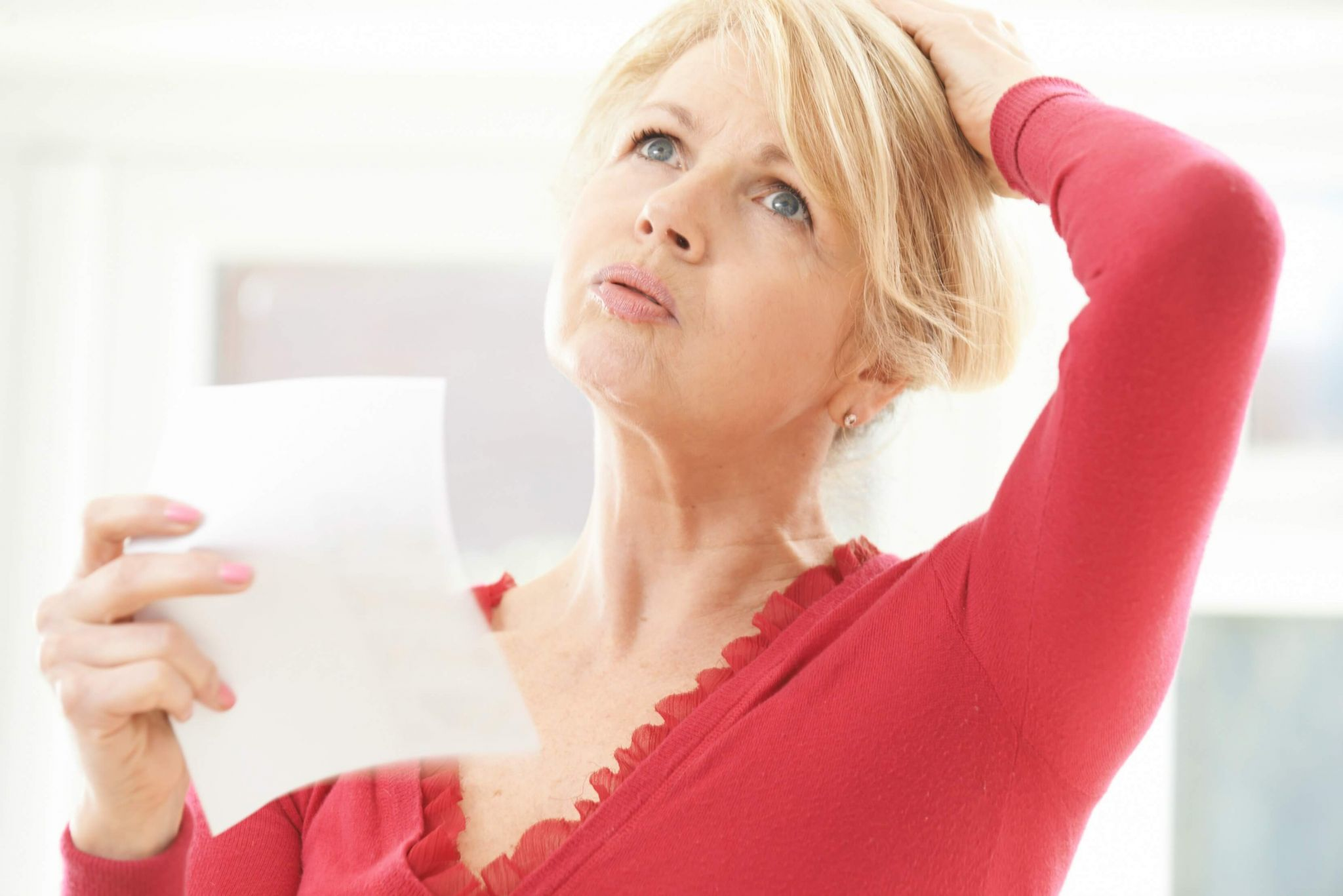 help with menopause symptoms - mature lady experiencing a hot flush