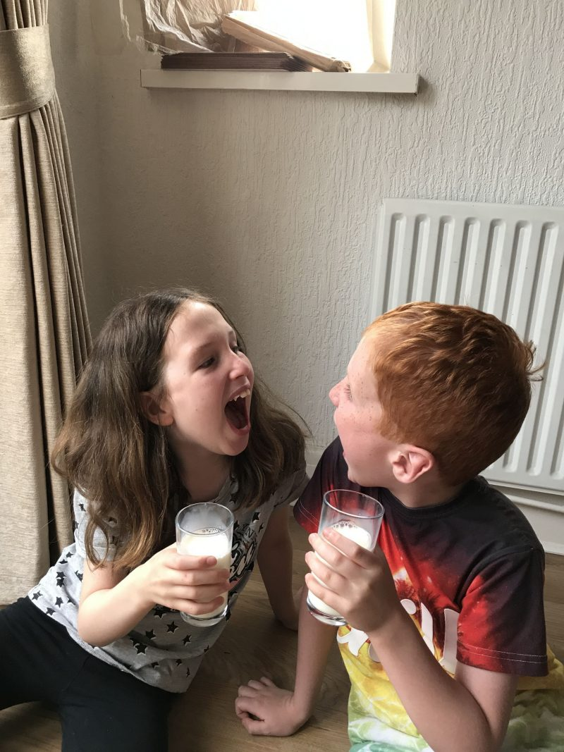 Caitlin & Ieuan Hobbis laughing together and drinking milk