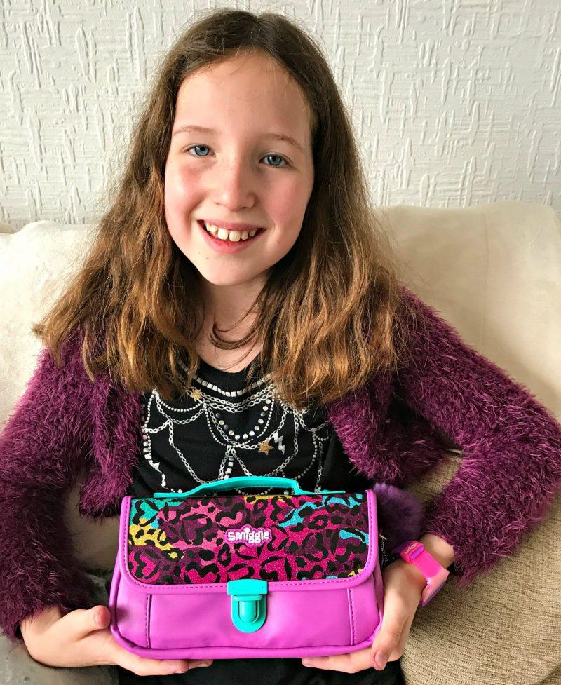 Caitlin holding Smiggle Handbag Pencil Case from the B2S2017 range