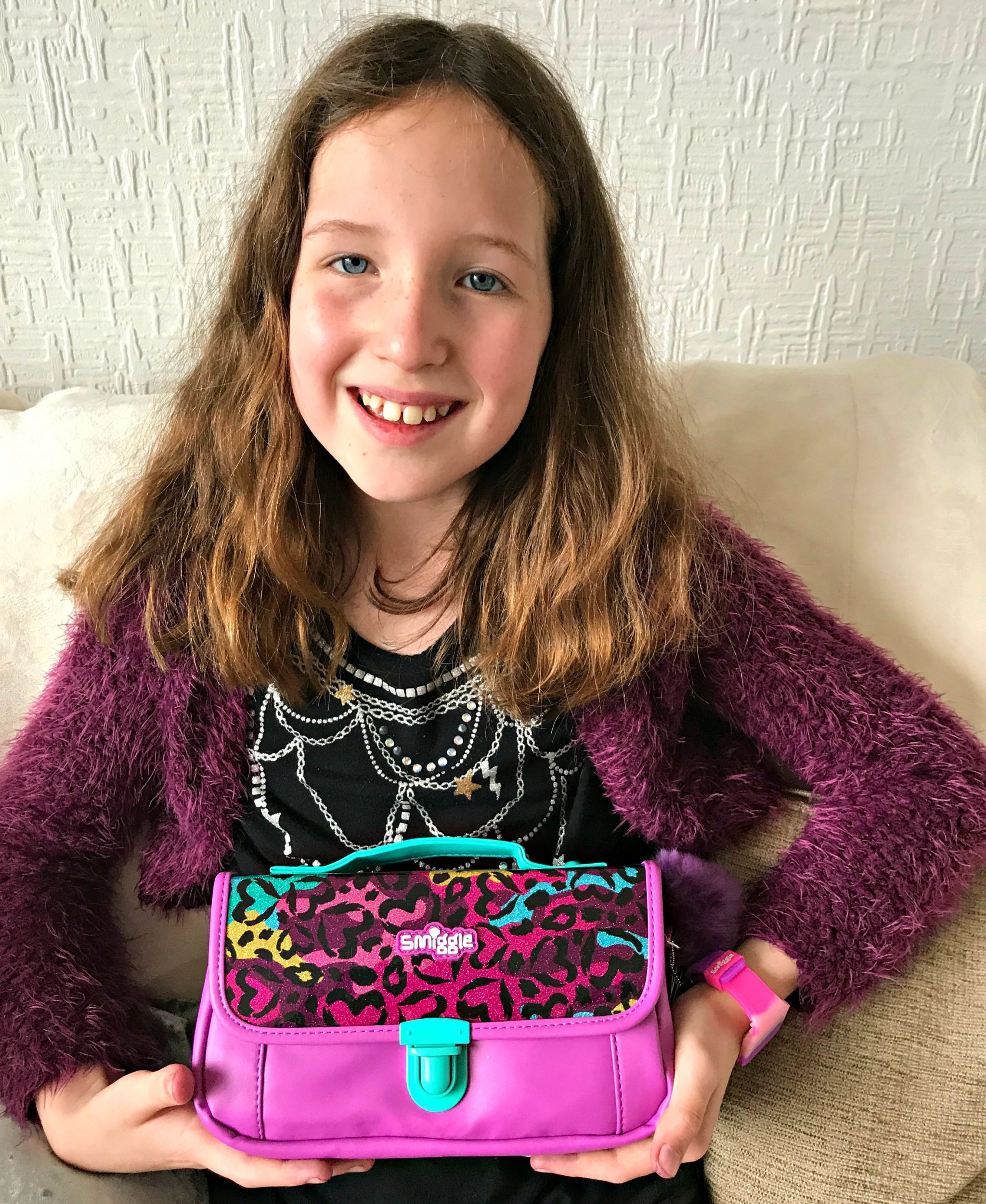 Caitlin holding Smiggle Handbag Pencil Case from the B2S2017 range