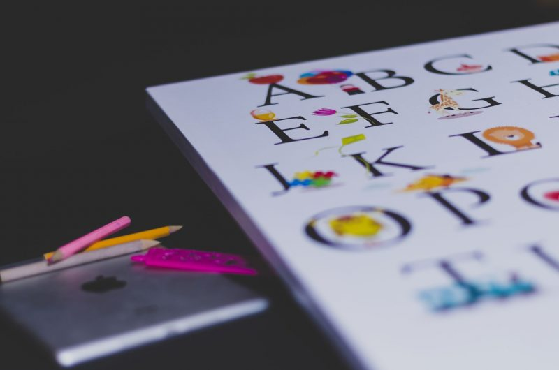 Child's alphabet and colouring pencils