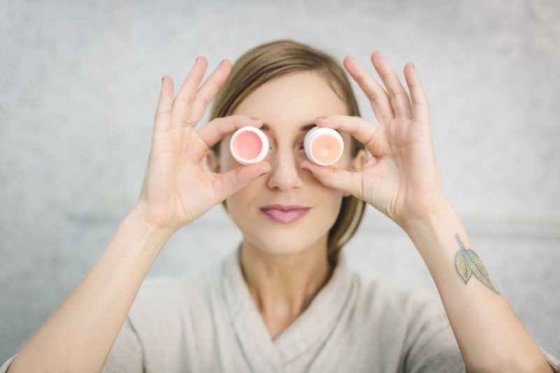 woman holding lip balm in front of her eyes, beauty reviews, beauty, motherdistracted.co.uk