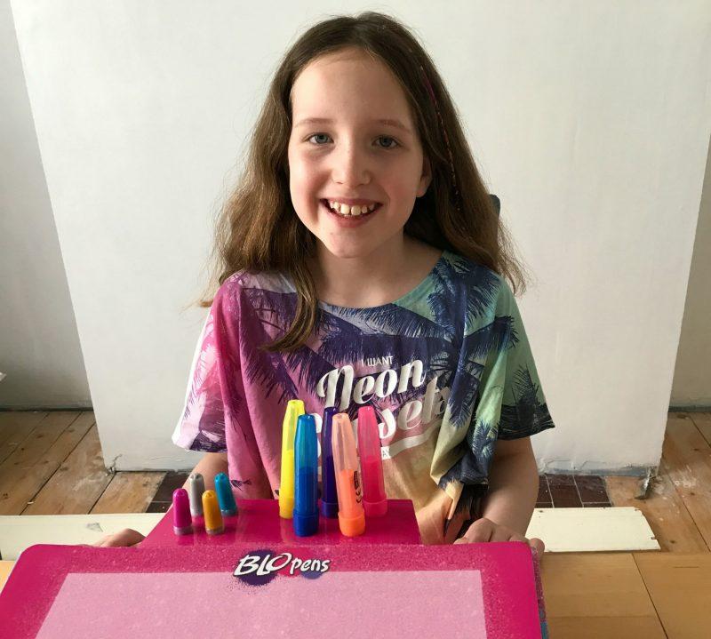 Caitlin with BLOPENS Glitter Studio set up