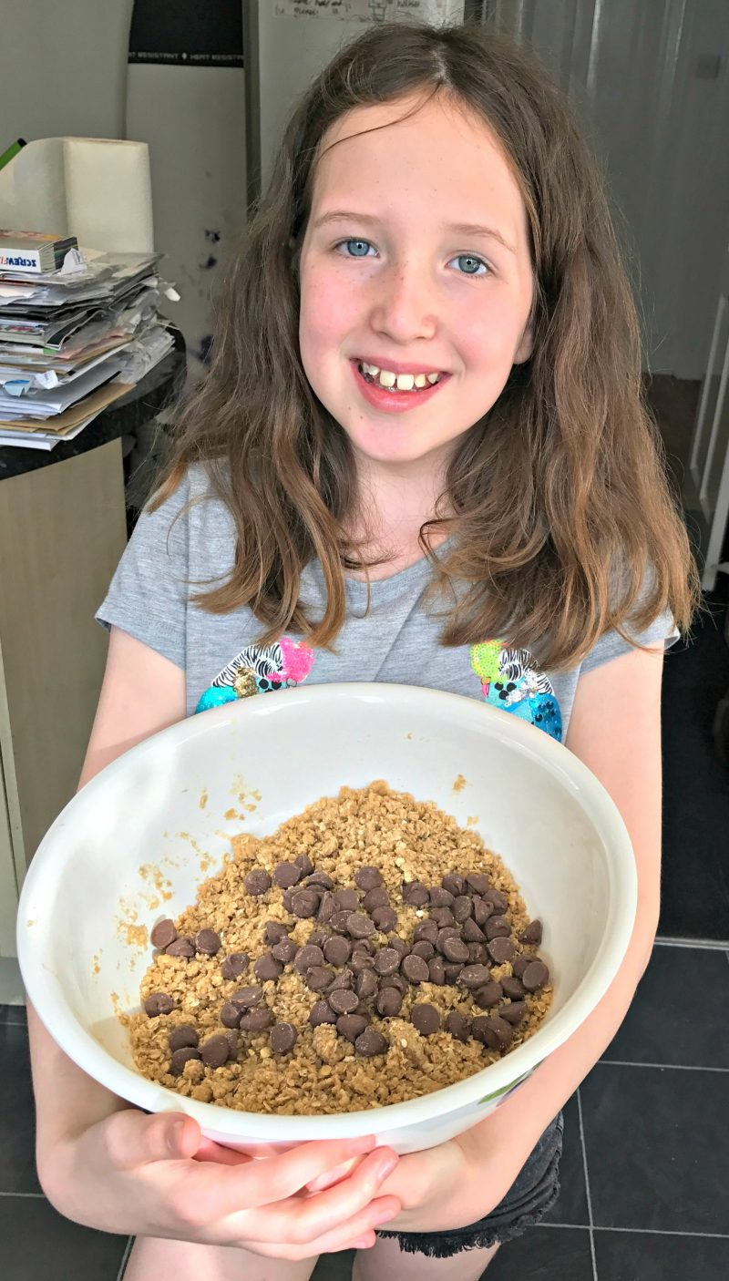 Caitlin holding the mixing bowl with the crumble mix
