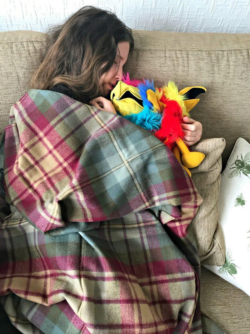 Caitlin snuggling up under The Tartan Blanket Co. Auld Scotland Tartan Blanket