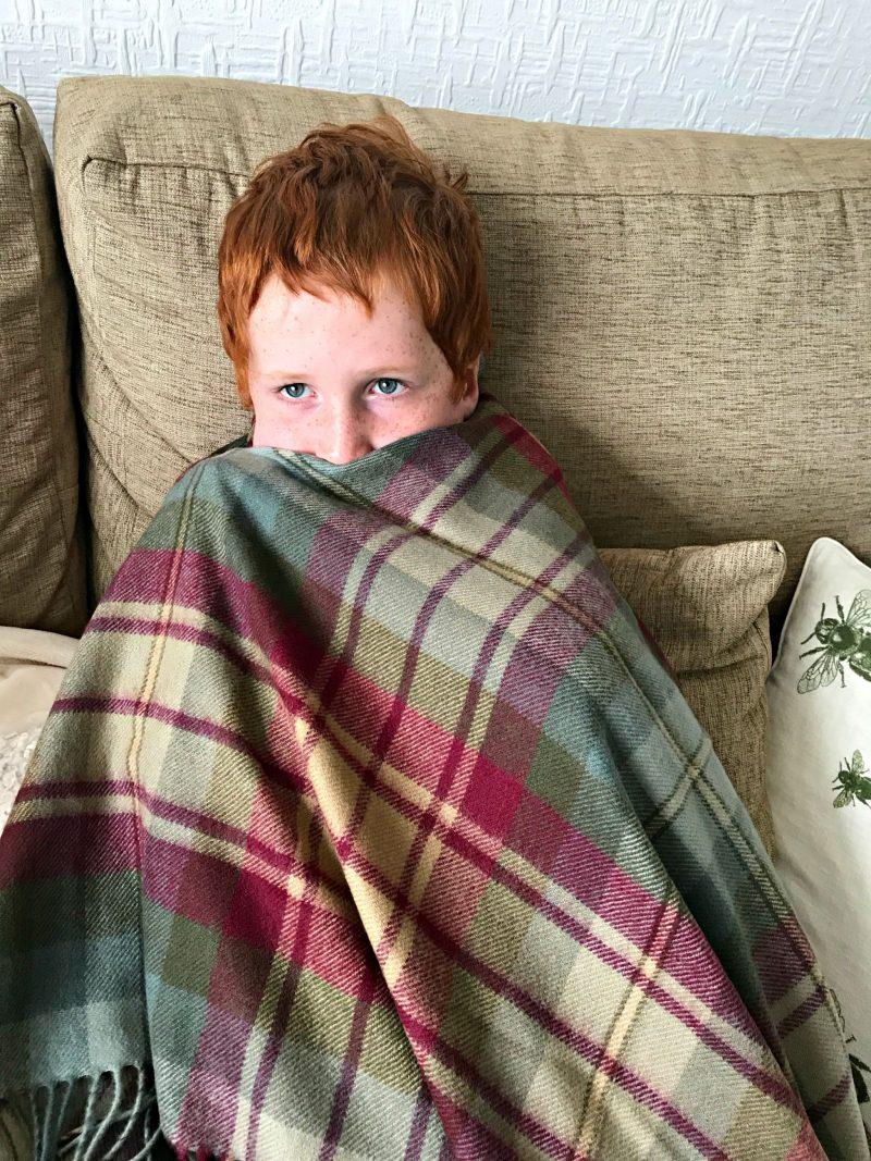 Ieuan wearing The Tartan Blanket Co. Auld Scotland Tartan Blanket