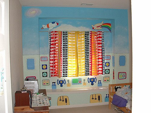Brightly coloured child's bedroom with stencils on walls - motherdistracted.co.uk
