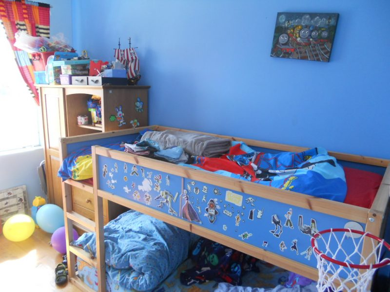 Bright blue bedroom with bunkbeds