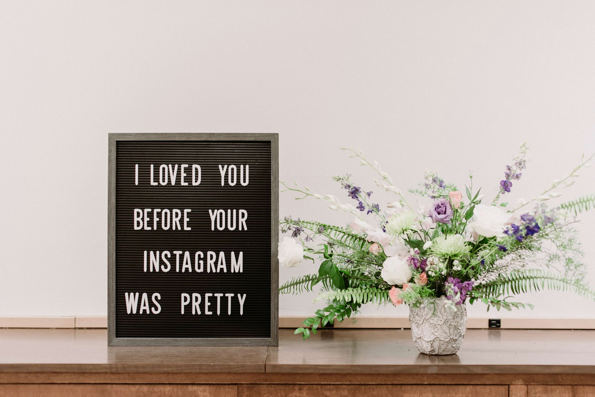 "work from home blogger - sign saying ""I loved you before your instagram was pretty"""