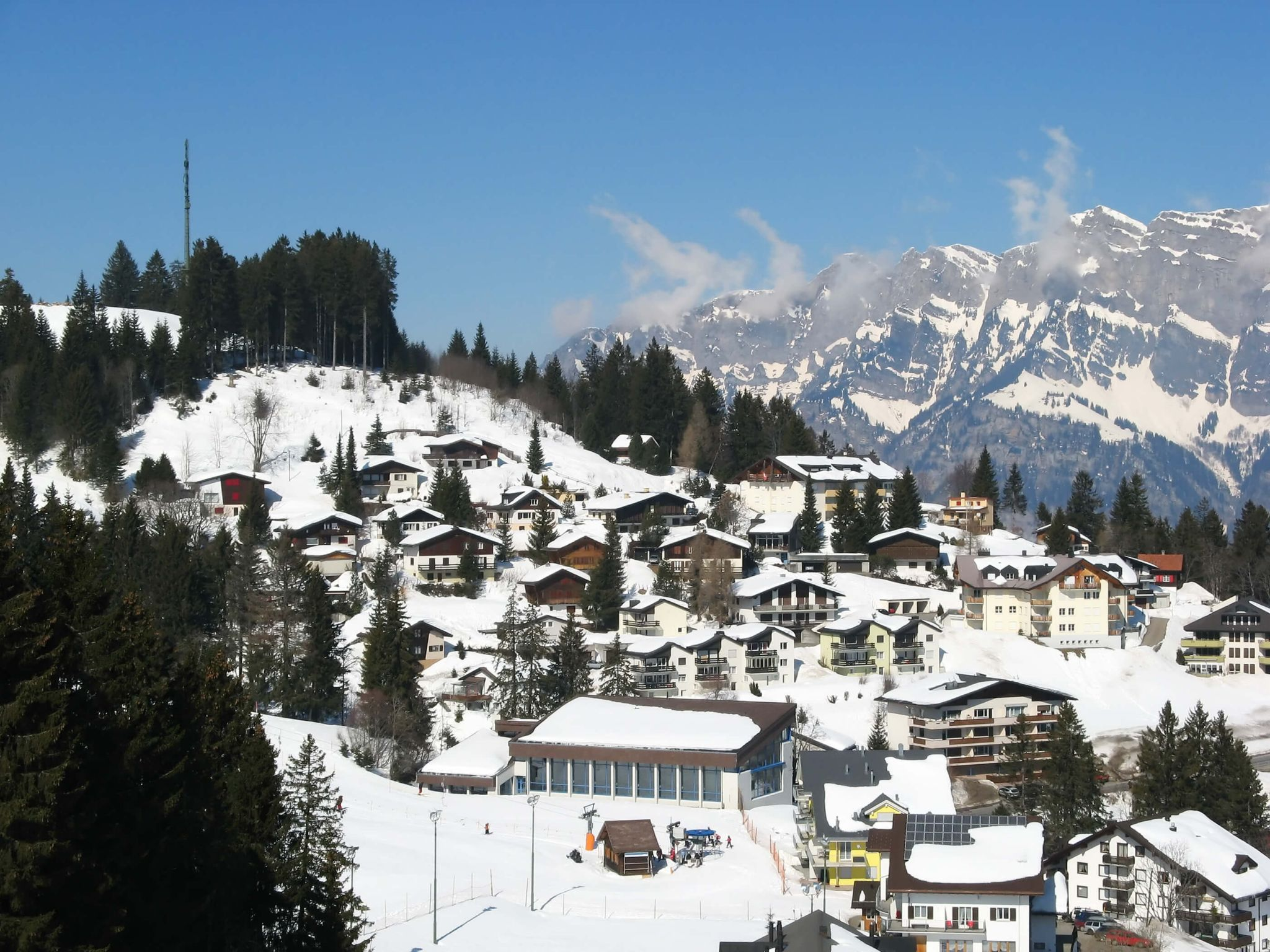 ski holiday with kids - an alpine town in the snow