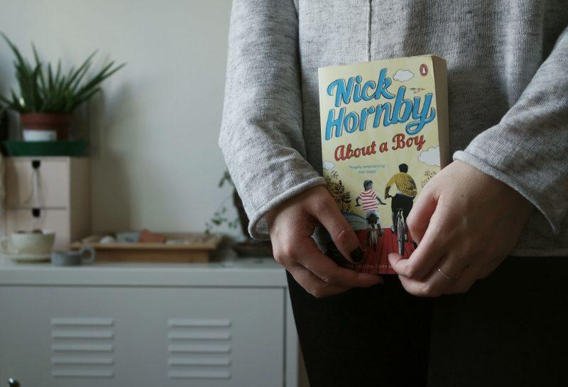 agony aunt online - woman holding a romantic novel