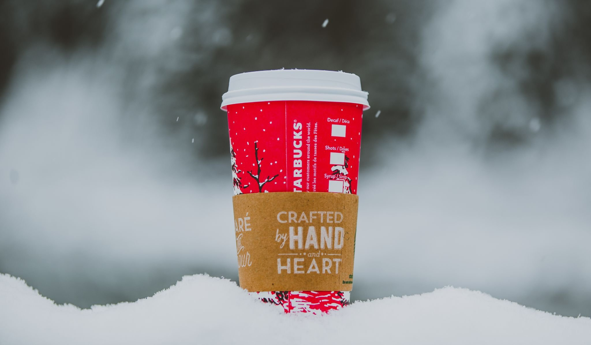 save cash for Christmas - red take-away coffee cup on snow