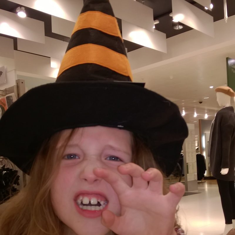 Caitlin wearing a witches hat