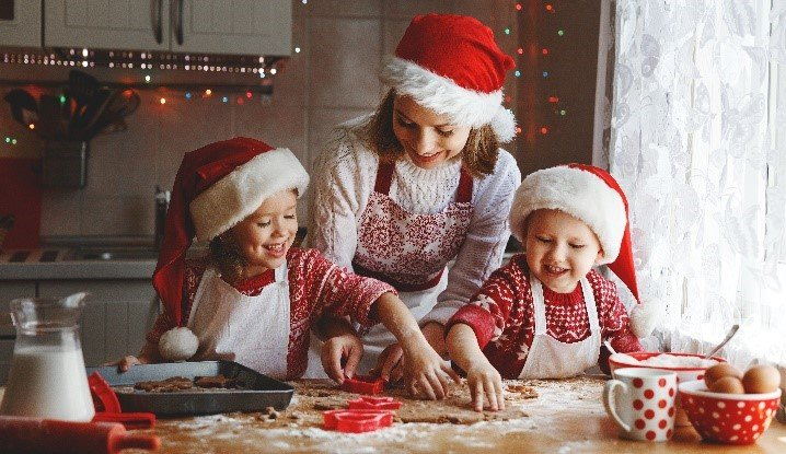 Mum and her daughters making Christmas Cookies at home