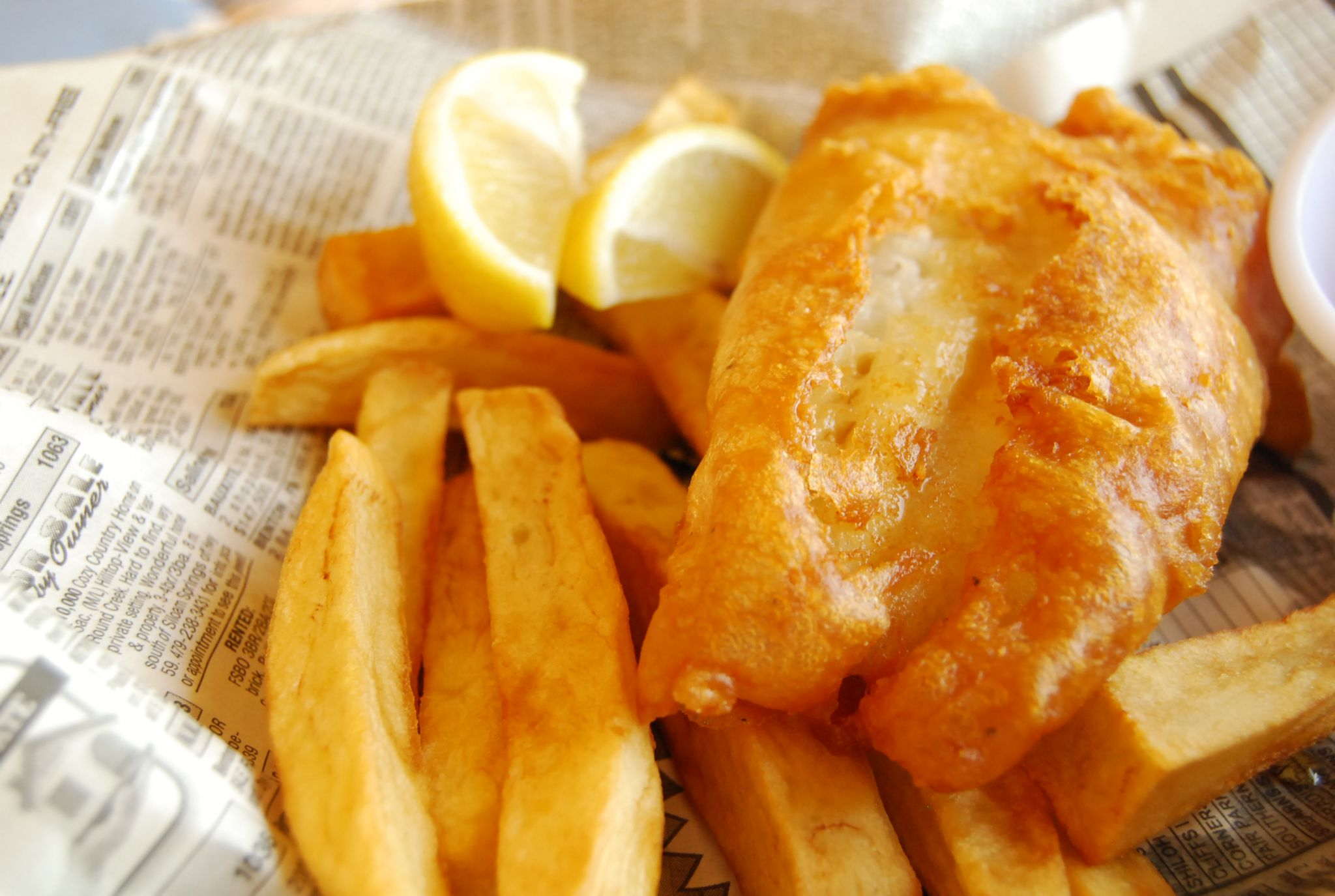 reduce food waste at home - fish and chips on newspaper