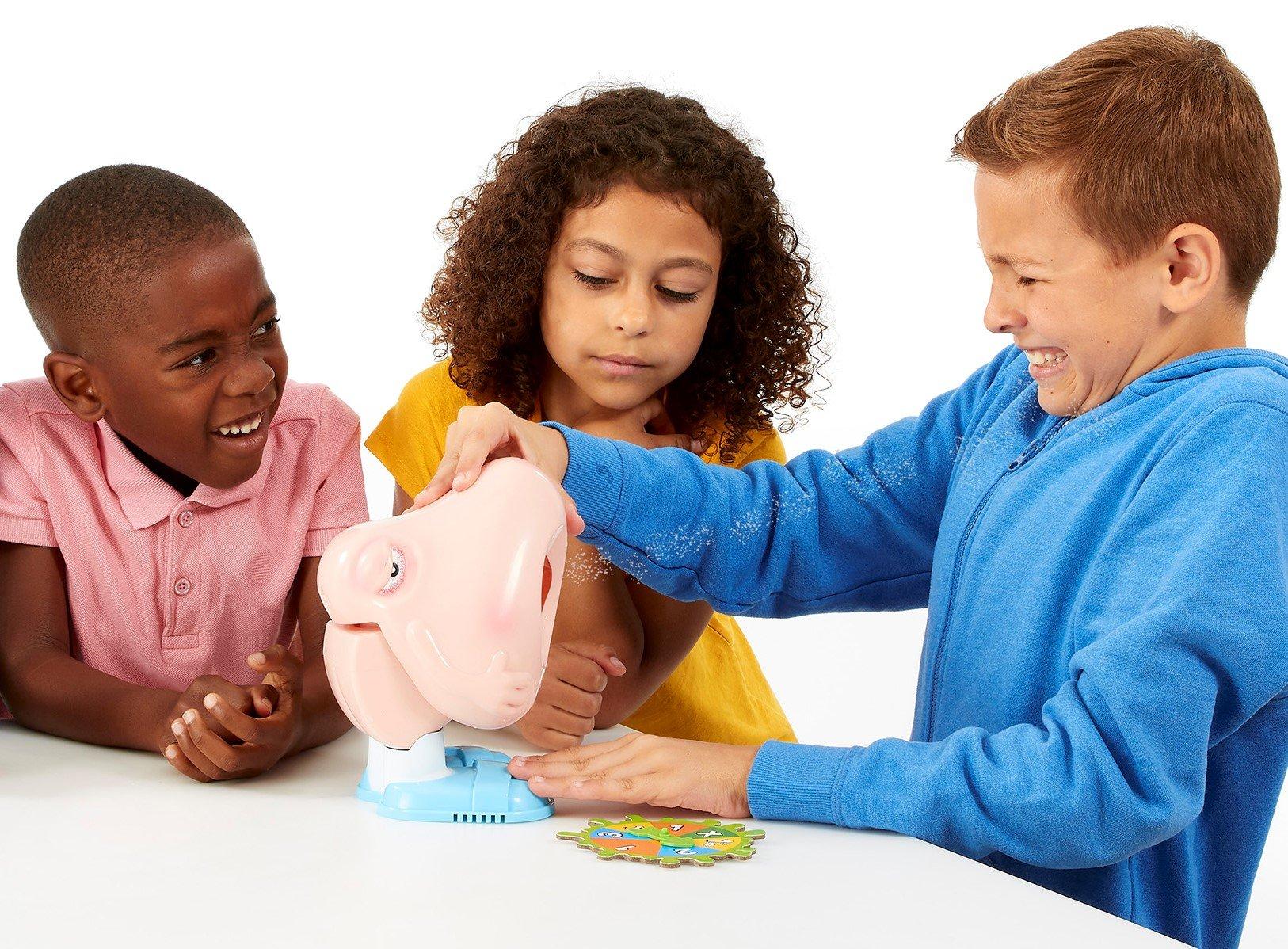 Three children playing Snotcha!