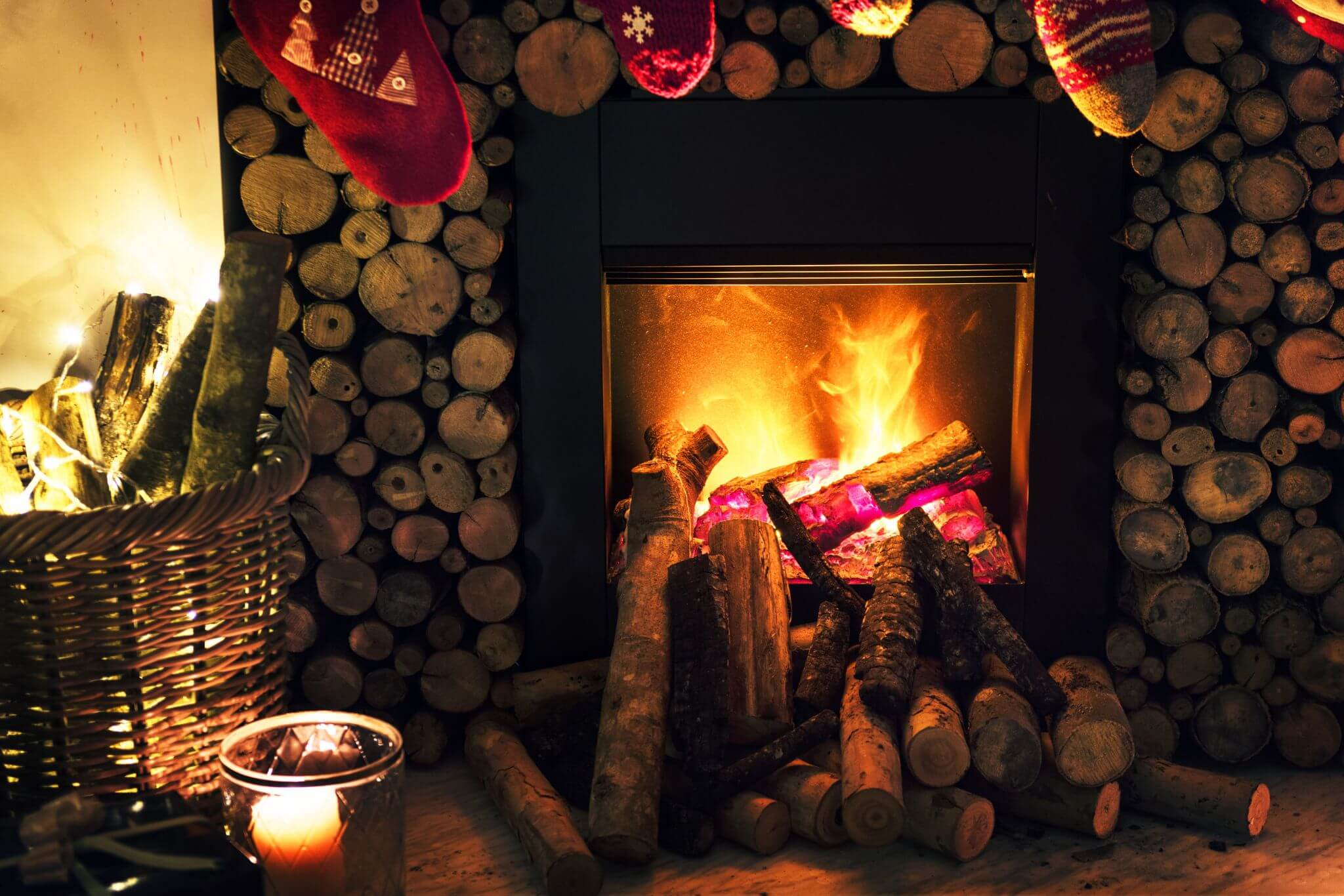 carbon monoxide awareness - do you know the risks - wood stacked up around an open fire place