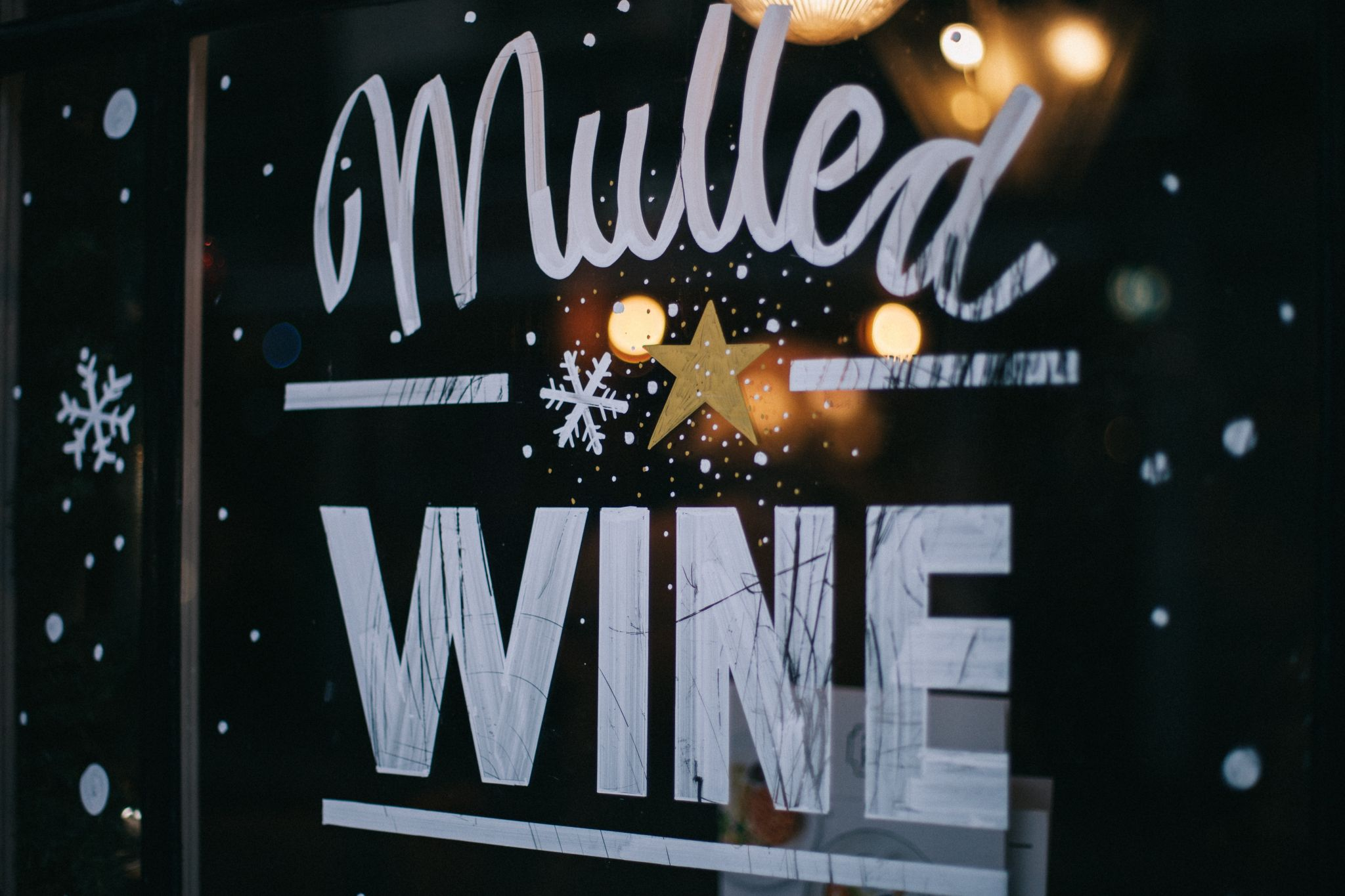 Cafe window advertising mulled wine - last minute office christmas party ideas