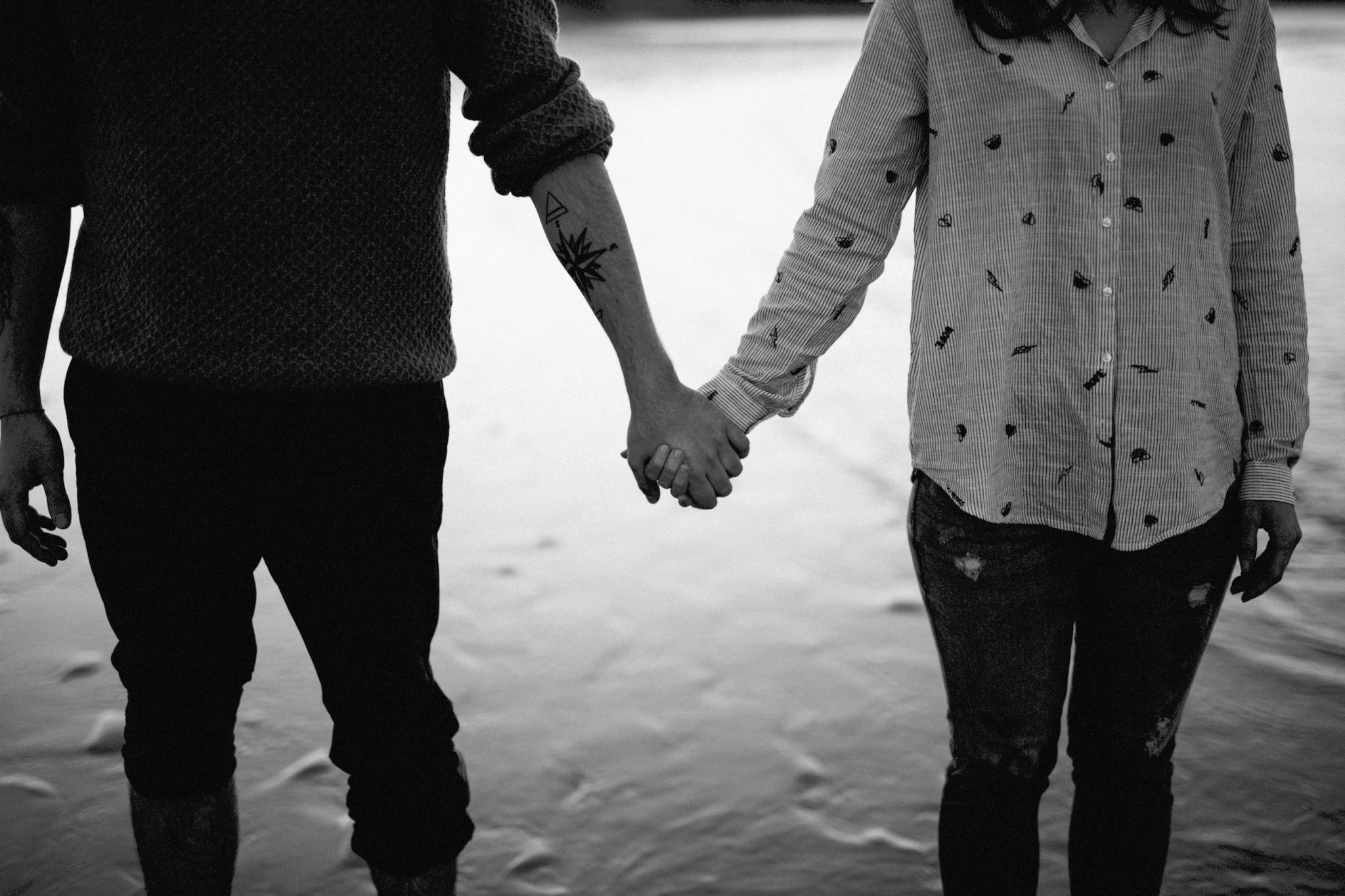 couple holding hands on a beach