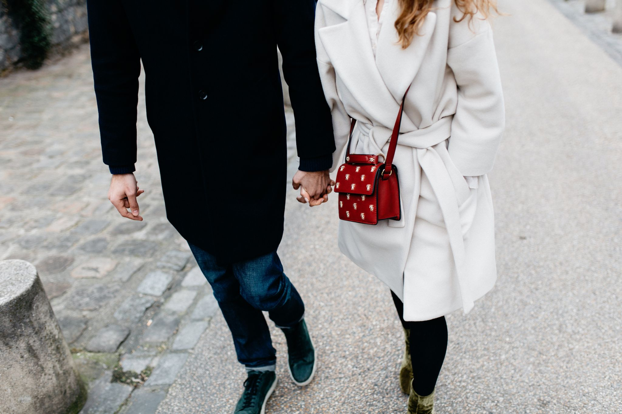 when should I meet his parents - man in black coat and woman in white coat holding hands