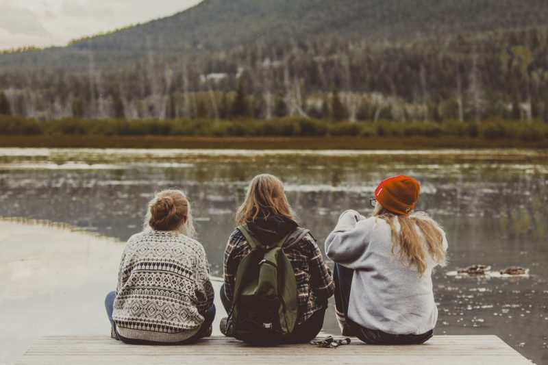 3 girls looking over a lake