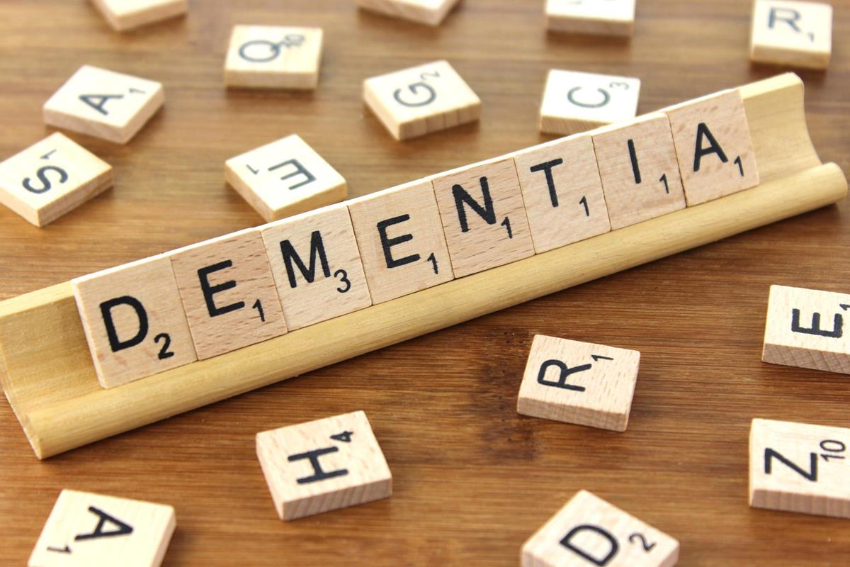 Early signs of dementia. Dementia spelled out in scrabble tiles