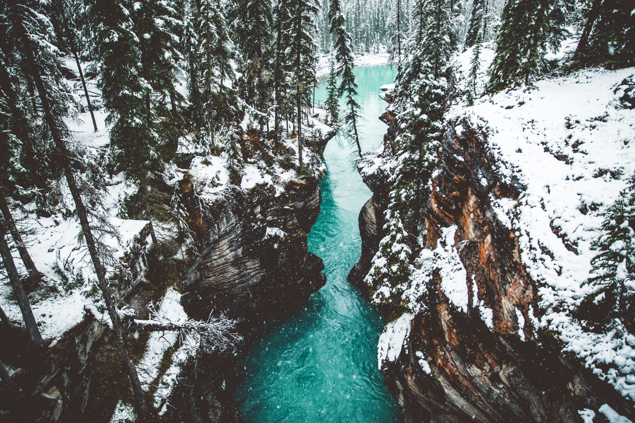 Blue river flowing through a snowy ravine - Mother Distracted Problem Page From Agony Aunt & Relationship Coach Linda Hobbis