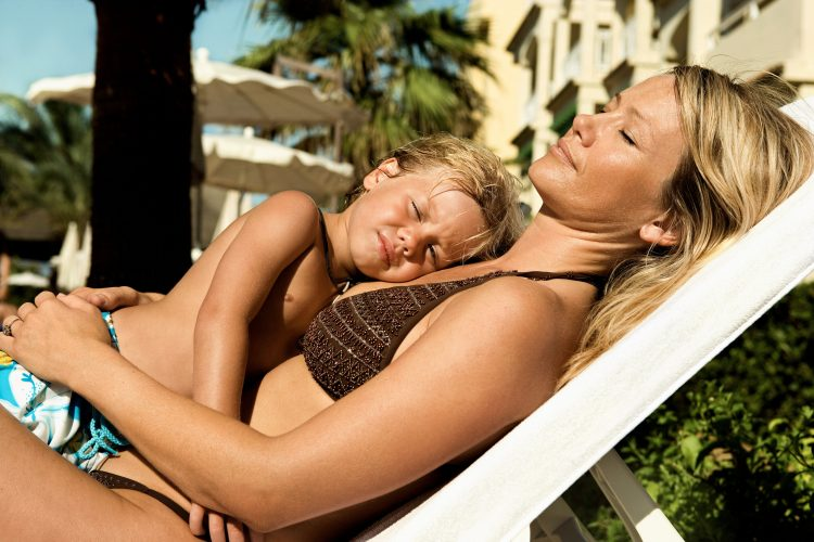 Quality time with your kids - do you spend more than an hour at day with them? Mum and son on a sunbed on holiday