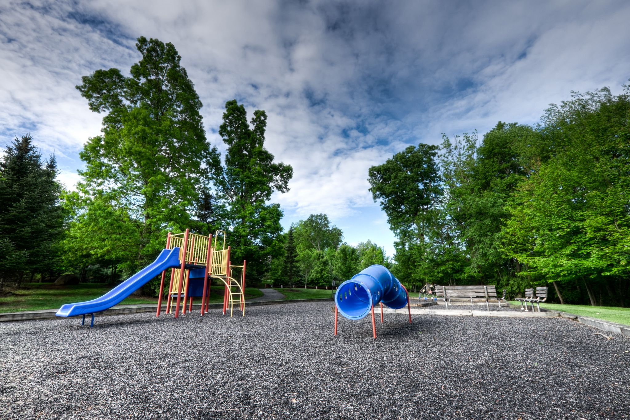 Have you any half term activities planned for the spring half term? Empty children's playground under a stormy sky