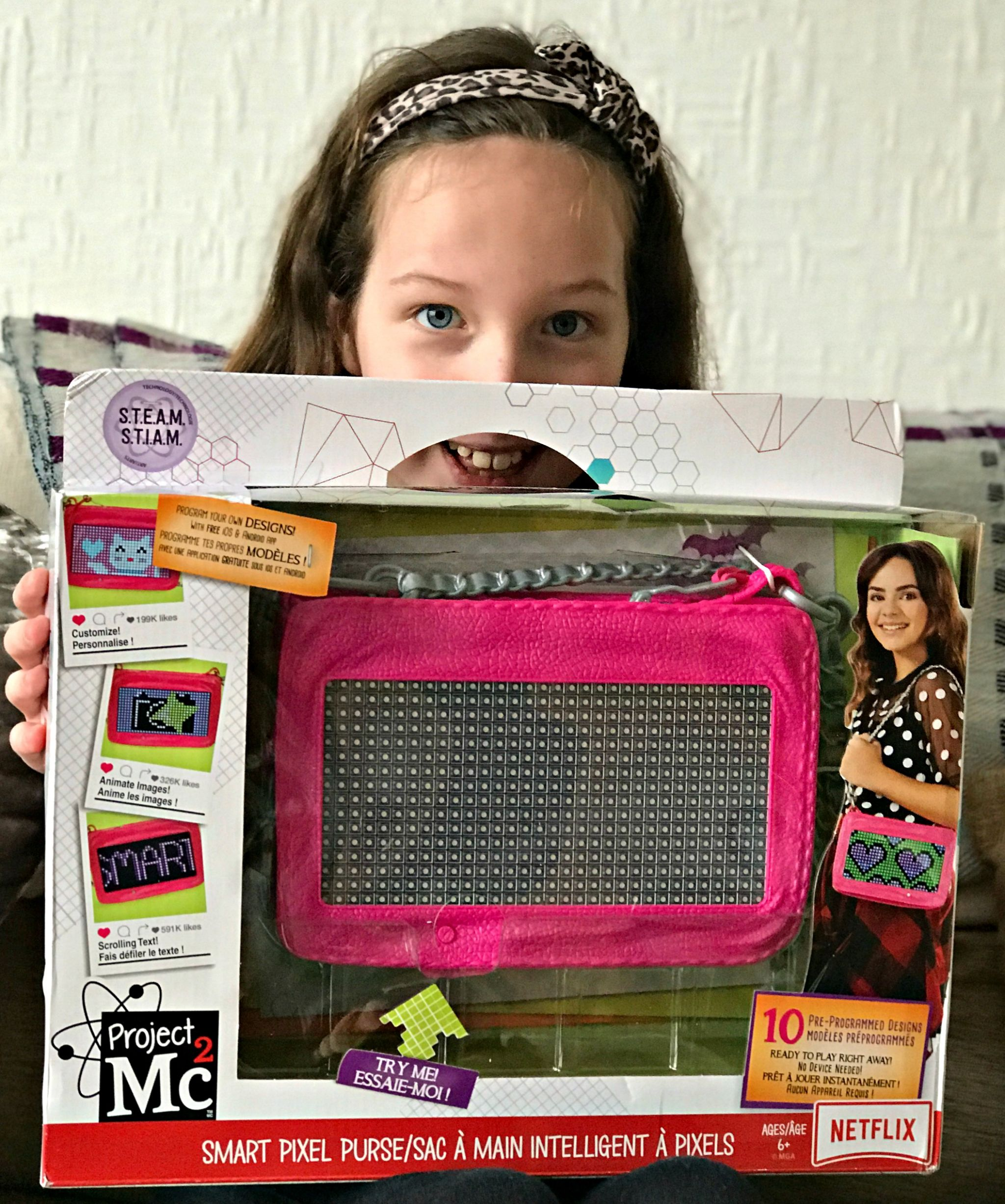 Project Mc2 Pixel Purse - Caitlin holding the box and smiling