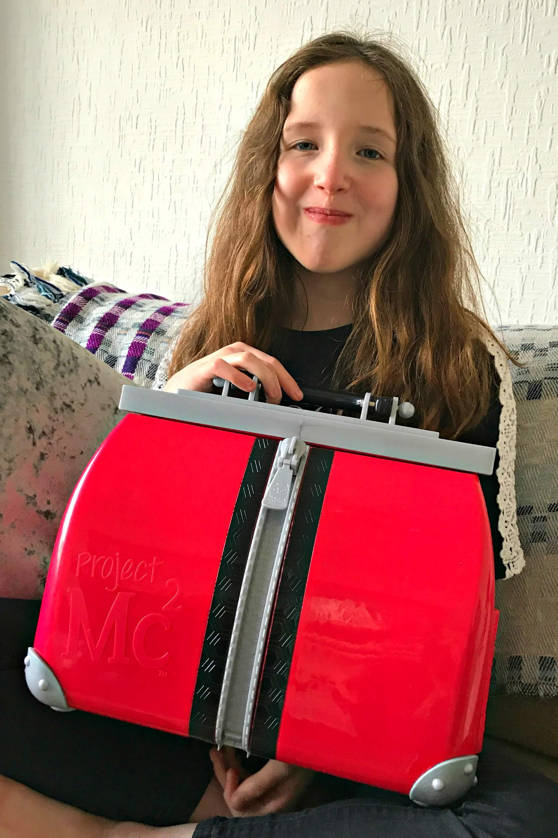 Caitlin holding the red Project mc2 ultimate lab kit bag