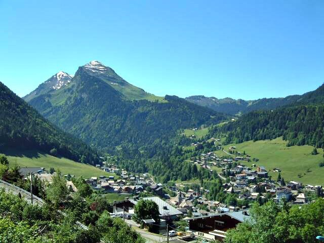 alpine town in summer - reasons to visit the alps