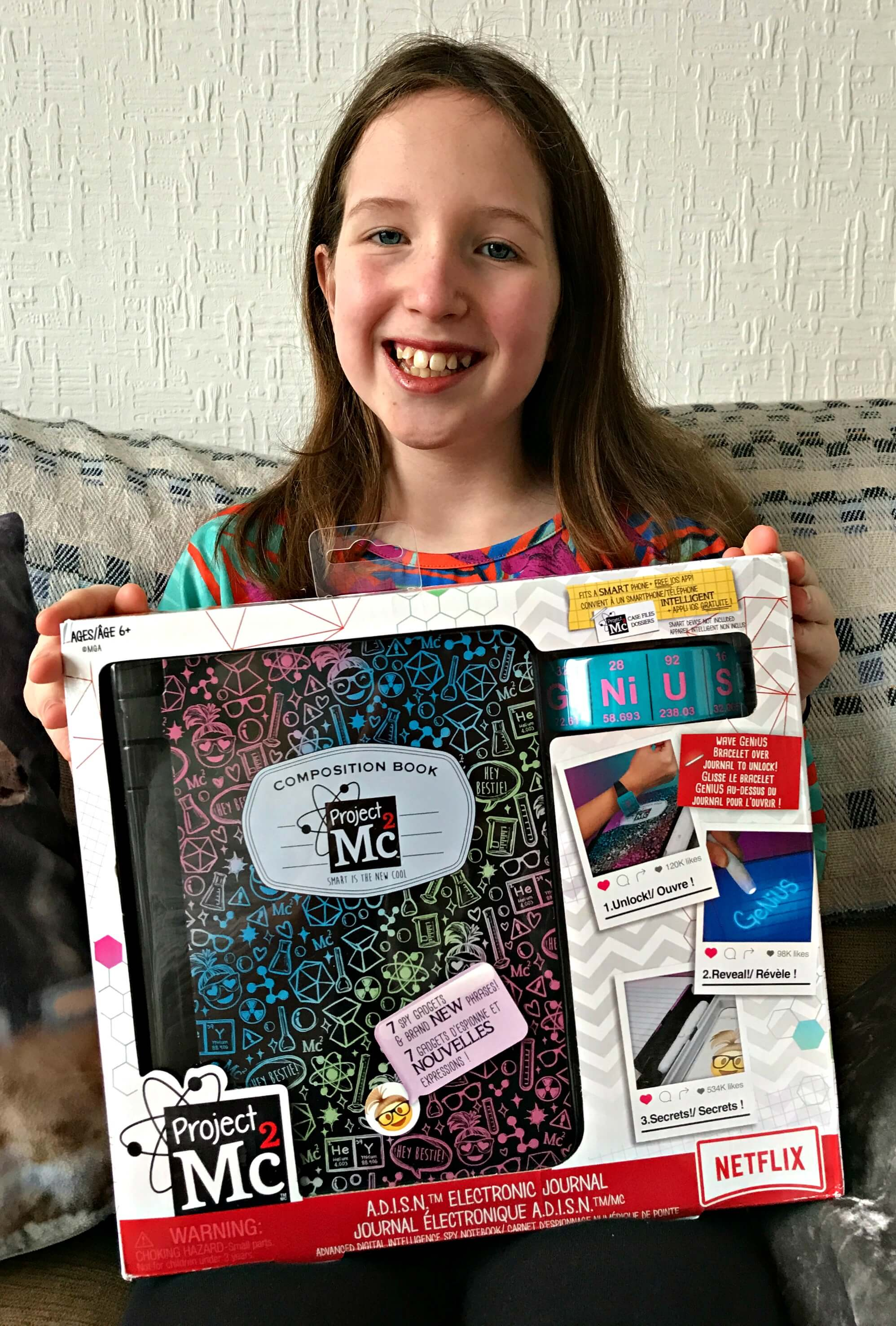 Project Mc2 A.D.I.S.N. Electronic Journal box held by Caitlin