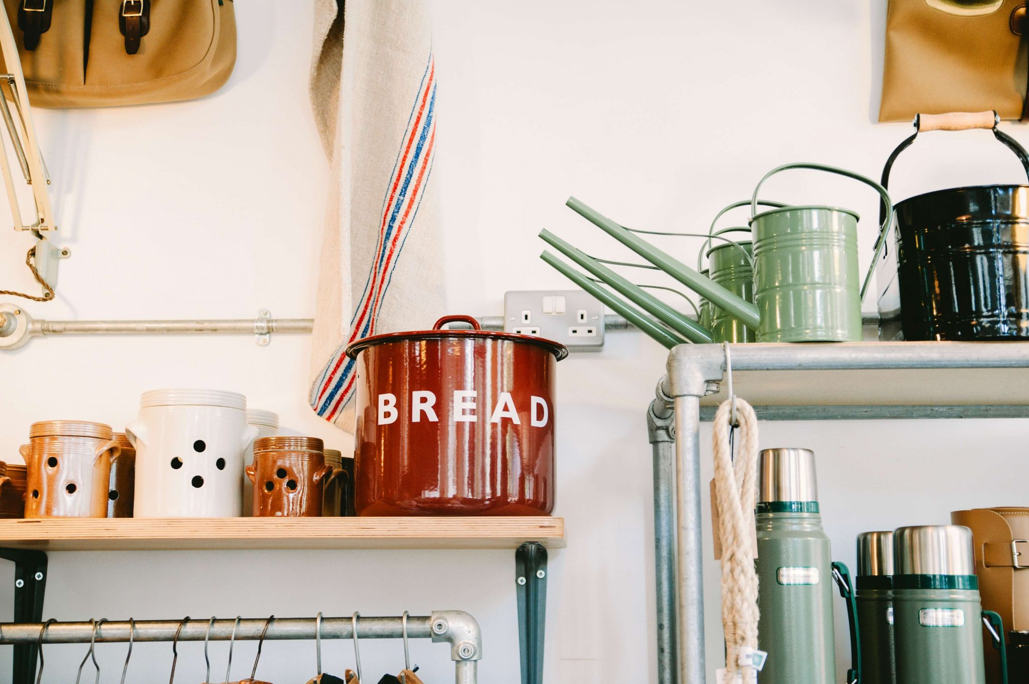 Transform your kitchen on a budget - shelves crowded with ornaments, cans and flasks
